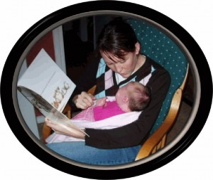 Listening to Possum Magic at just three days old - ten years on,  she's now reading everything!