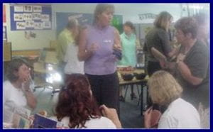 Jenny, my library manager, talking to the principal and teachers about our new resources. princi